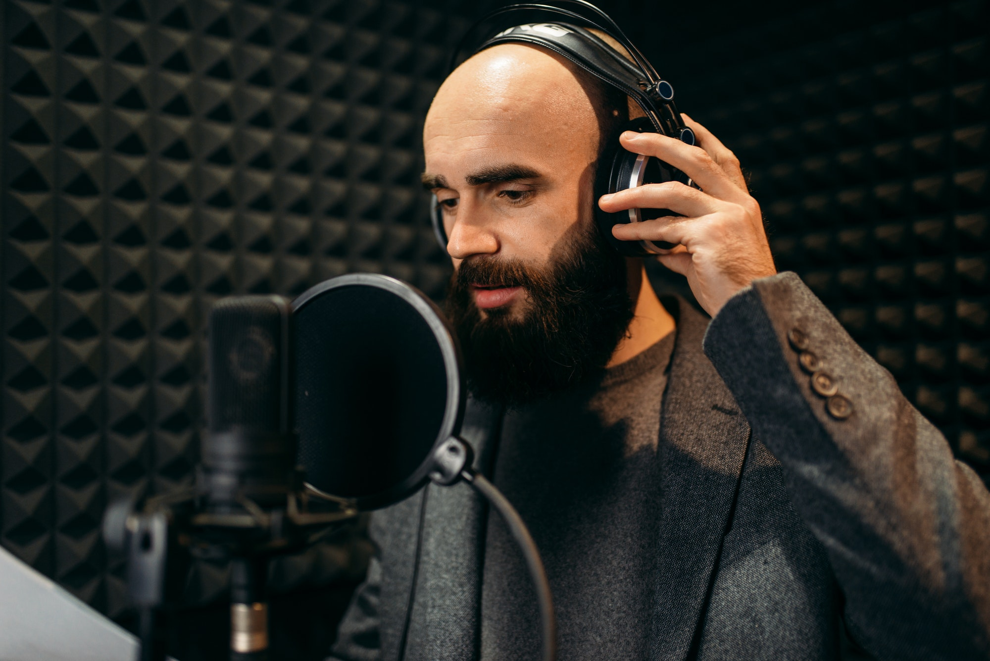 Male singer songs in audio recording studio